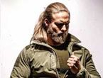 Blonde bearded scandinavian man in green jacket