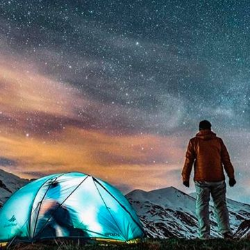 Man observing sky in night time