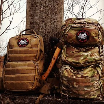 Bags beside a three in the forest